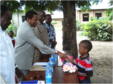 Man handing paper to young boy