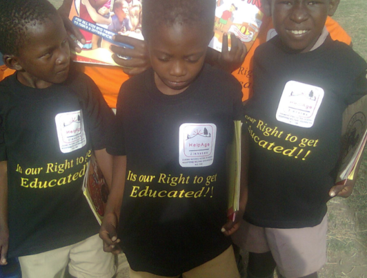 """kids in t-shirts that say """"It's our right to get educated."""""""