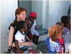 Kerry Olson sitting with children around her