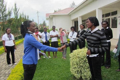 Young women shaking hands outdoors