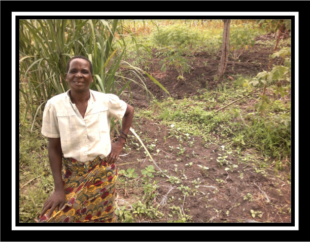 A woman standing in front of a garden in Zambia