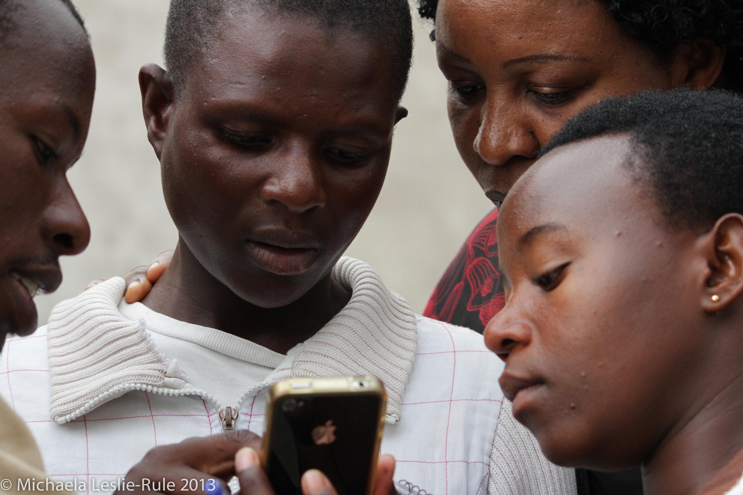 Africn girls look at an iPhone