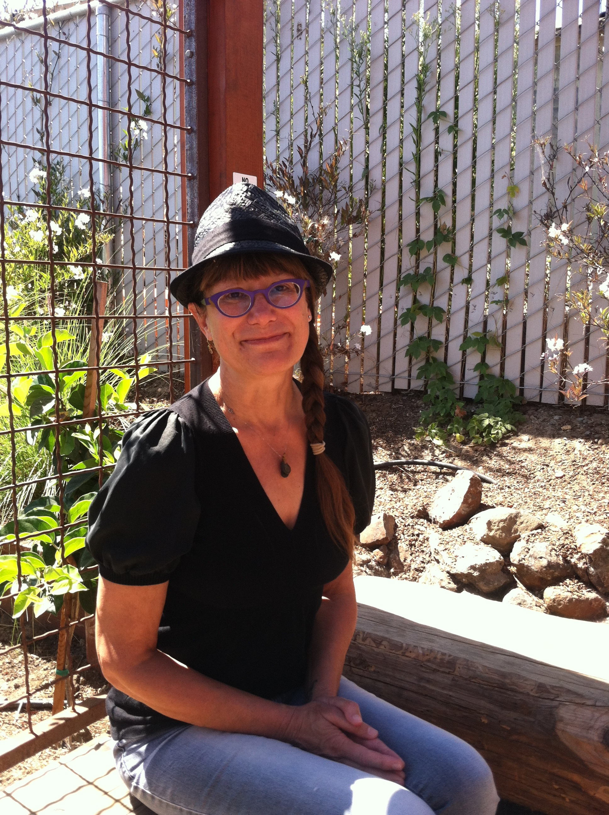Kathleen Genco sits outdoors at her brewery, Discretion Brewing