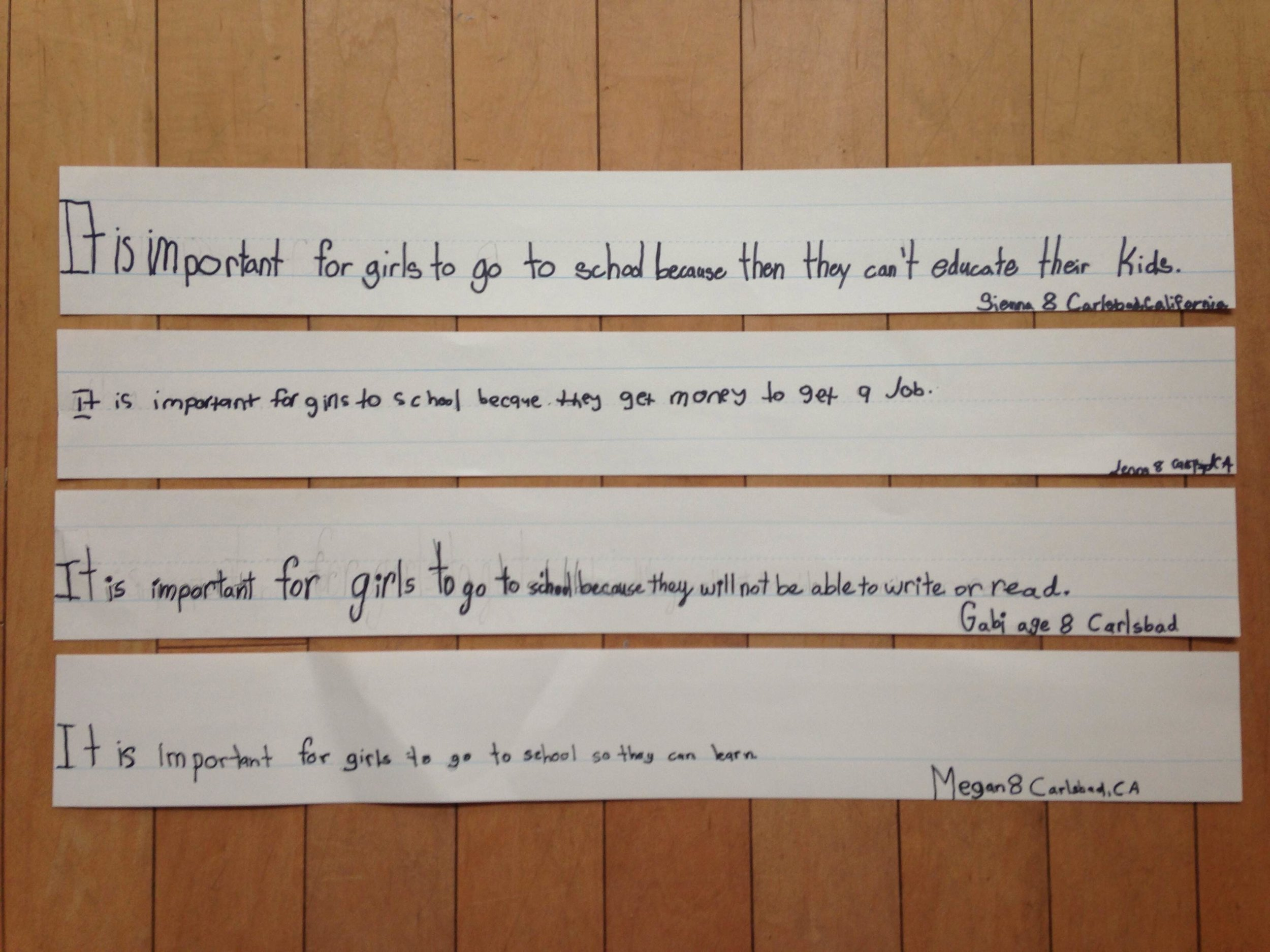 five hand written quotes from a third grade class about why girls should go to school