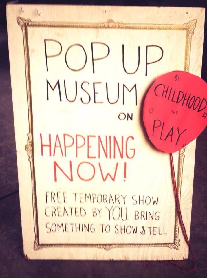 A sign that announces the pop up museum