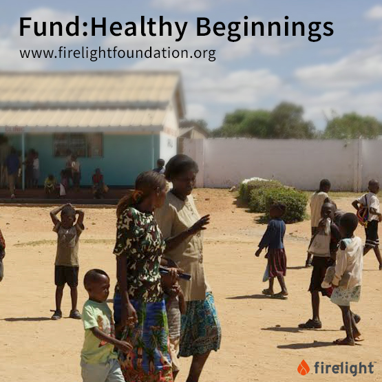 The front yard of a clinic in Zambia where children and women area walking and playing