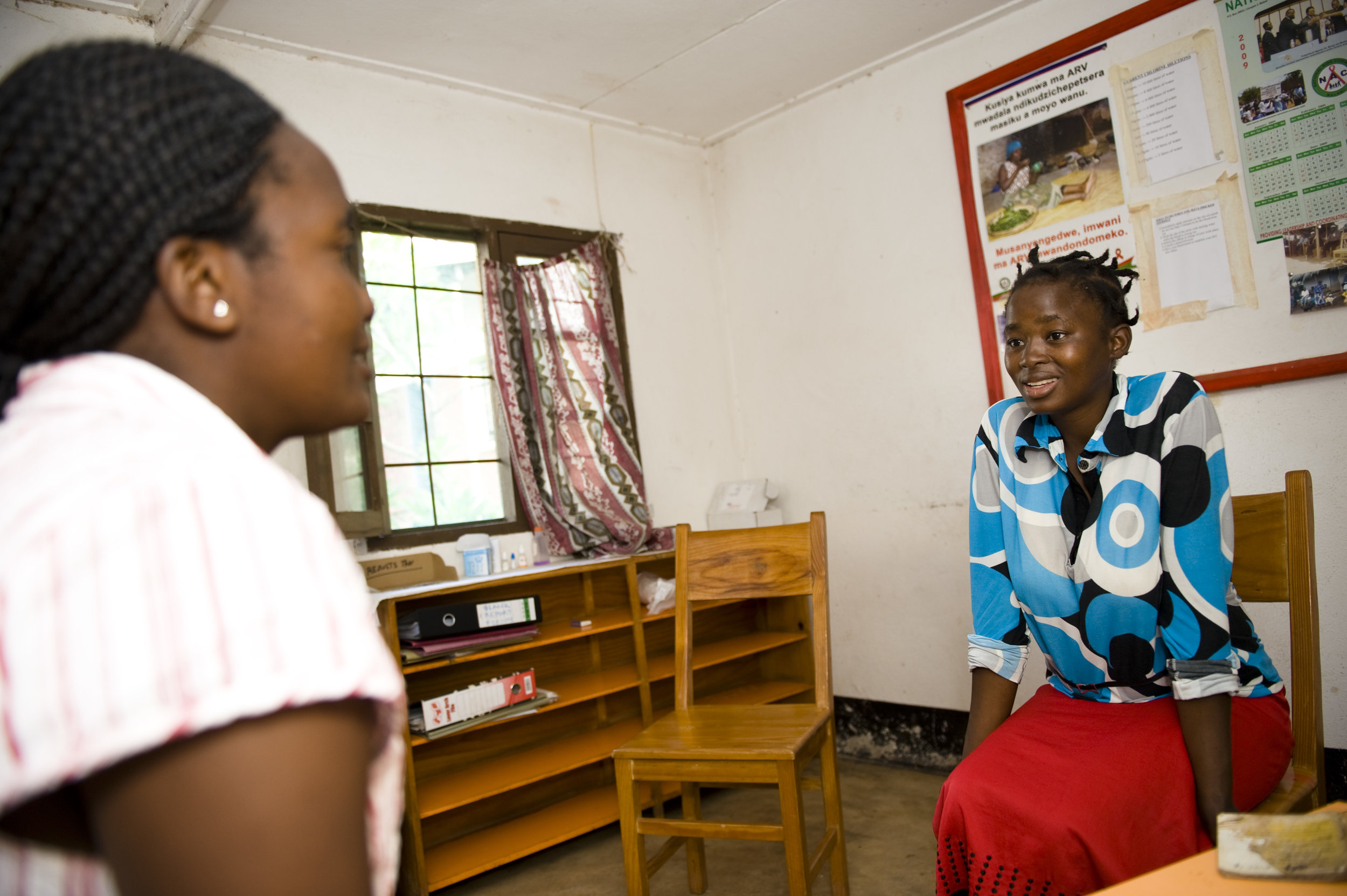 A woman talks with a counselor at a community testing facility