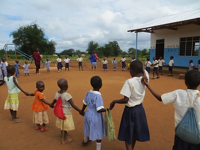 Children playing outside the Early Childhood Development Center at Safina Women's Association