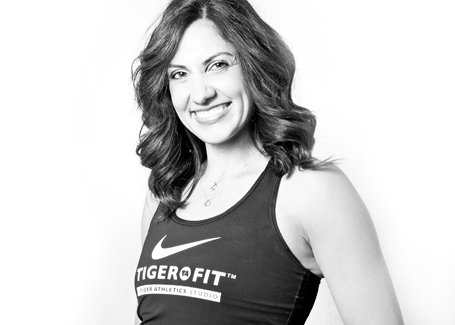 ERIKA WINKELS - Erika's strong athletic background in gymnastics is a great complement to the functional training philosophy at TigerFit. She focuses on challenging, results-based sessions, delivering functional, innovative trainings to encourage well-rounded athletic development. Erika's favorite things about teaching are building relationships with people in her classes, great music and pushing people through intense sweat sessions so they can reach new personal goals.