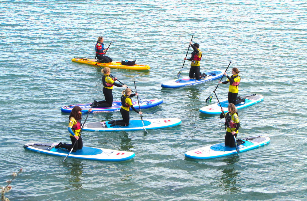 Some of our lovely guests getting to grips with SUP on our Cornwall SUP and Yoga Retreat!