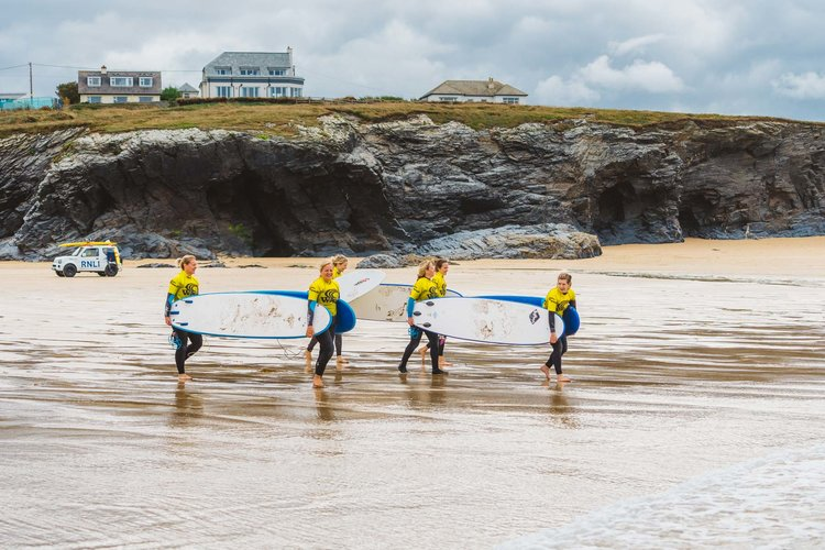 Lovely guests heading to the sea for their first ever surf lesson!