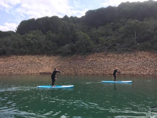 Guests getting to grips with Stand Up Paddling on the gorgeous lake…