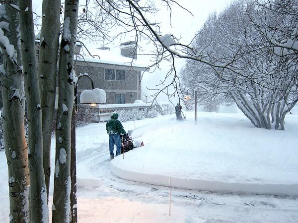Men plowing snow