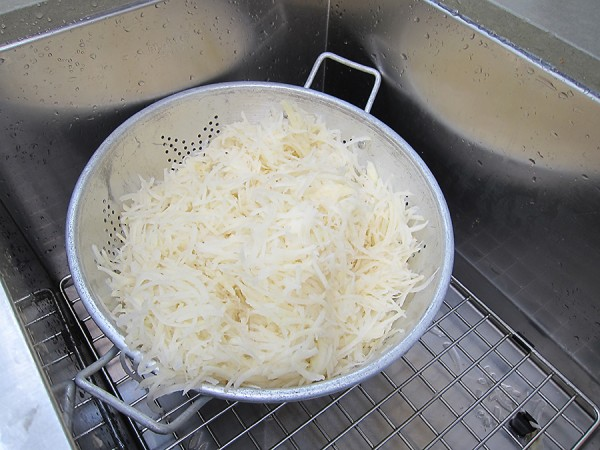 Grated potatoes draining