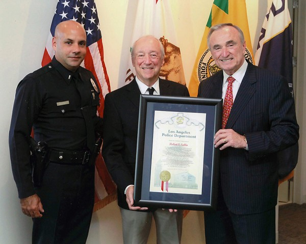Chief WilliamBratton, Captain Jorge Rodirquez, presenting commendation to my husband