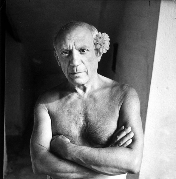 Picasso with flower behind his ear