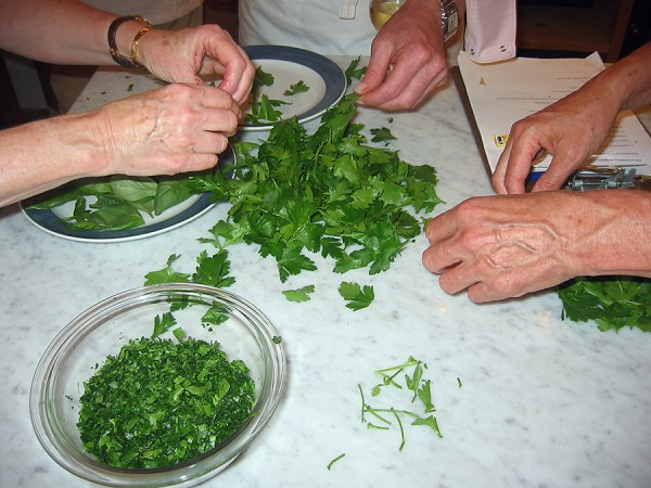 picking and separating parsley leaves for Duck Lasagna