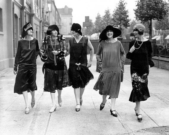 5 women in vintage dresses