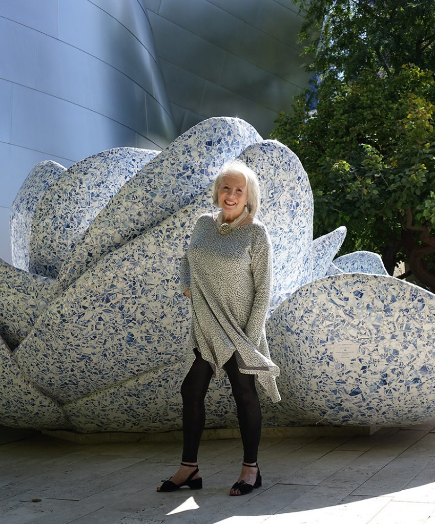 Sandra Sallin in front of A Rose for Lilly fountain at the Walt Disney Concert Hall in lLos Angeles