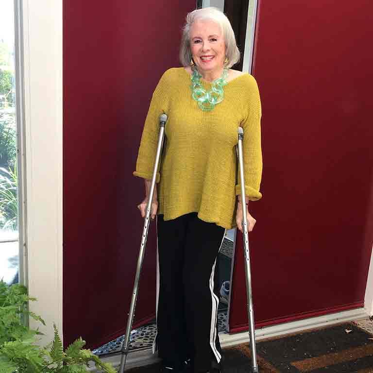 Sandra with crutches