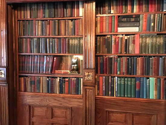 The library of books at the entrance to The Magic Castle