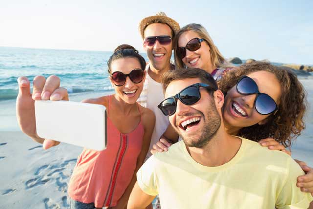 group-of-young-adults-taking-a-selfie-at-the-beach.jpg