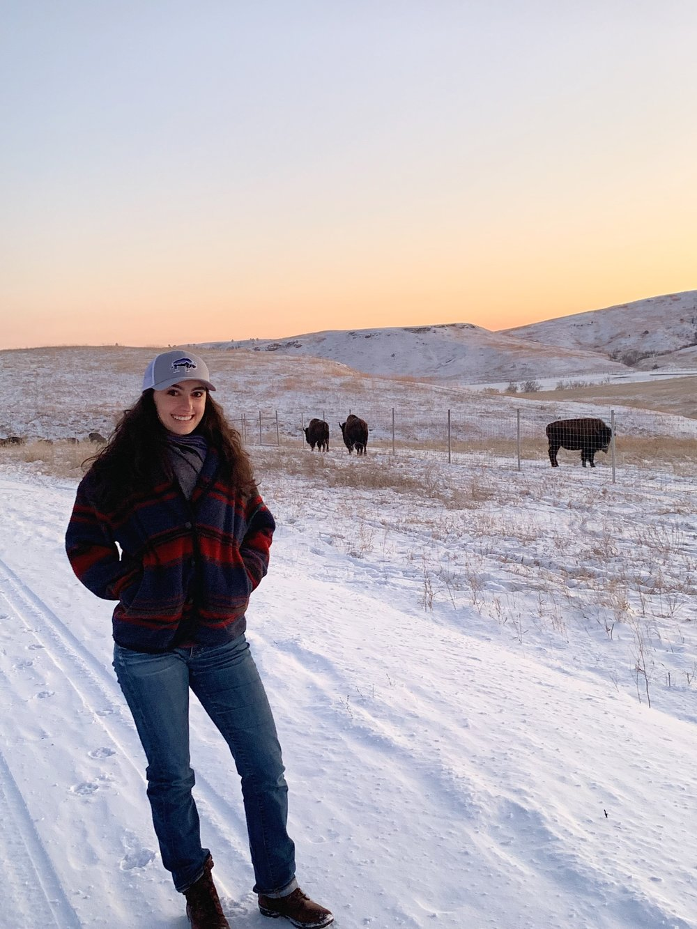When the coast was clear, we jumped out of the truck and got a photo of me WITH THE BISON!