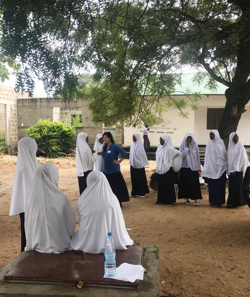 An image of Ashley directing/devising a play in Zanzibar, Tanzania with a group of young Zanzibarian women. The play was about issues in the Zanzibarian community and was created with GETheatre as part of Ashley's course Devising Social Justice Theatre for the University of Denver.