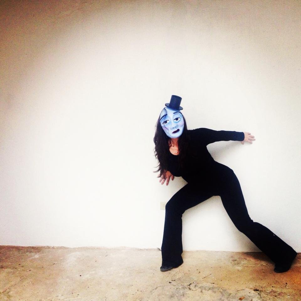 An image of Ashley performing in mask for a street performance in the middle of San Juan, Puerto Rico.