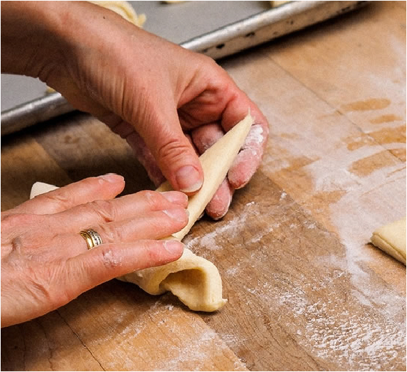 Hand rolling our croissants ensures freshness and quality every time.
