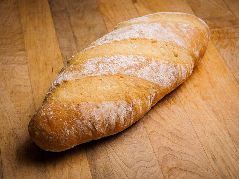 Breads - All through the night, seven days a week, our bread bakers are busy in the kitchen preparing the bread for that day. Each of our loaves are hand rolled and made using all natural ingredients and no preservatives.