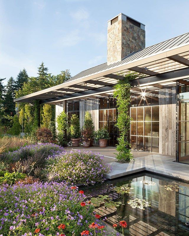 "Architect @OlsonKundig designed this beautiful Portland house with barn-like architecture and lush gardens. . Stunning vistas of rolling hills are visible through walls of glass. . ""The materials used, style of the structure and ample gardens blend the house seamlessly with its natural surroundings."" . via: Homedit 
