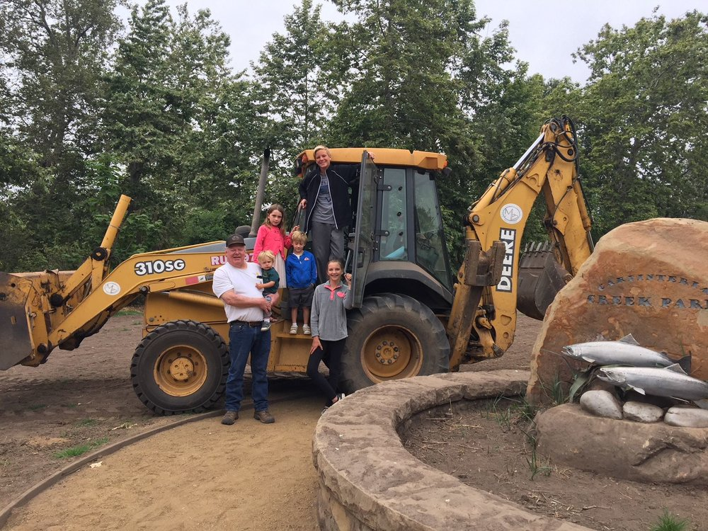 We support our local schools - Mac Brown, owner of Mac Brown Excavating, appears with one of his tractors and five of his grandkids, Zach, Kate and Amelia Isaac, and Luke and Jake Brown. The tractor company recently donated to CEF to fund an art program at all CUSD elementary schools.