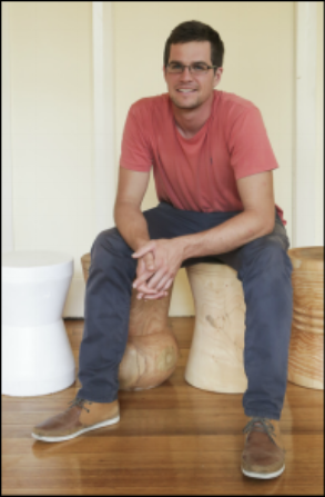 Thats me, looking a little younger, sitting on one of the first sets of our stools. - …made from a tree in Malvern.