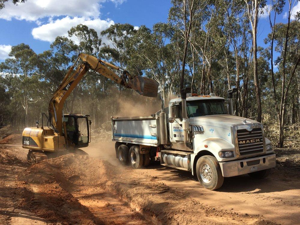 Excavator loading truck