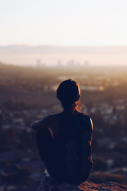 reflective woman overlooking city.jpg