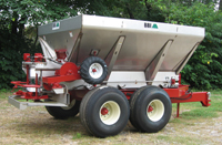 Liberty Mechanical Fertilizer Lime Spreader - The Liberty Mechanical Fertilizer Lime Spreader is 10 ft long, has a tandem axle and provides Medium Capacity for a variety of Applications. The Liberty Mechanical Drive Fertilizer Spreader features a Ground Wheel Drive Conveyor and PTO or Hydraulic Driven Spinners for an 80' spread pattern.