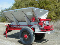 """Grasshopper 9ft Single Axle Mechanical Fertilizer Lime Spreader - Our high ground clearance 5 ton fertilizer – 7 ton lime spreader designed for precision application of top dressings and row cropping. A rounded payload capacity of 180 cu, ft. (6.7 cu. yds.), the stainless steel or carbon steel hopper is 9 ft. long and 8 ft. wide with 45 degree angle of repose sides. The ground clearance is 23"""" with standard 21.5 x 16.1 Flotation tires, minimizing compaction. Higher ground clearance can be achieved with optional 11.25 x 28 tires. A ground wheel drives the 16"""" stainless steel mesh chain for a spread rate automatically adjusting with travel speed. Spinners are powered by a PTO. or tractor supplied hydraulics"""