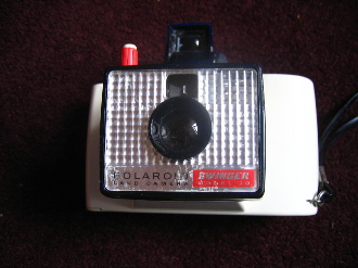 Vintage white polaroid collectable land camera very good condition.    I used to collect Polaroid cameras and had a collection of around 20 of them. This last remaining camera is my most beautiful one and I have never used it, it used to be displayed in my living room on a glass shelf. When I left University I set up partnership with a photographer and we used to run arts workshops in galleries and with community groups. Boots HQ is based in Nottingham and they used to donate out of date polaroid film tous which we would use in the workshops to create strange photo stories and each image usually had the tell tale signs of old stock – brown and blue water marks. Our arts organisation lasted for 2 years and then we went our separate ways – me to be an artist on my own, Jo to become a photographer.