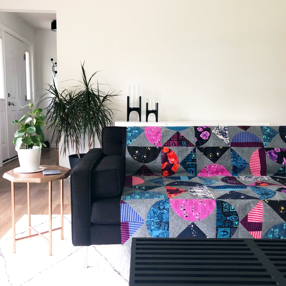 Pivot - Featuring Eclipse by Cotton + Steel. I was excited to try a version using a darker background and vibrant shades. This Halloween fabric with hot pinks, purples and blues compliments the Black Essex linen nicely.