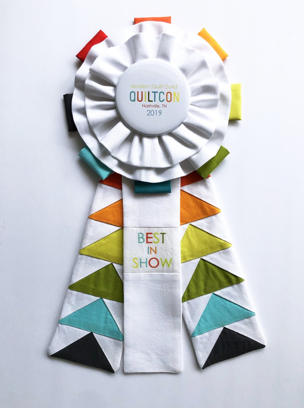Best in Show is the most fun and the most stressful one to make! This year I wanted to keep with the solid white style I usually stick with but add some quilty fun - thats where the flying geese came in. My good friend Guiseppea Ribaudo had a fantastic flying geese template I was able to use in just the right size.  Painter's Palette Solids by Paintbrush Studio Fabrics.