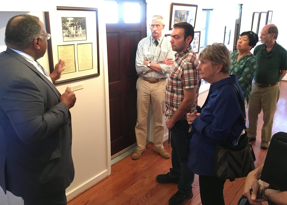 Participants learning about the history of the Baha'i community in Charleston while touring the Louis G. Gregory Baha'i Museum.
