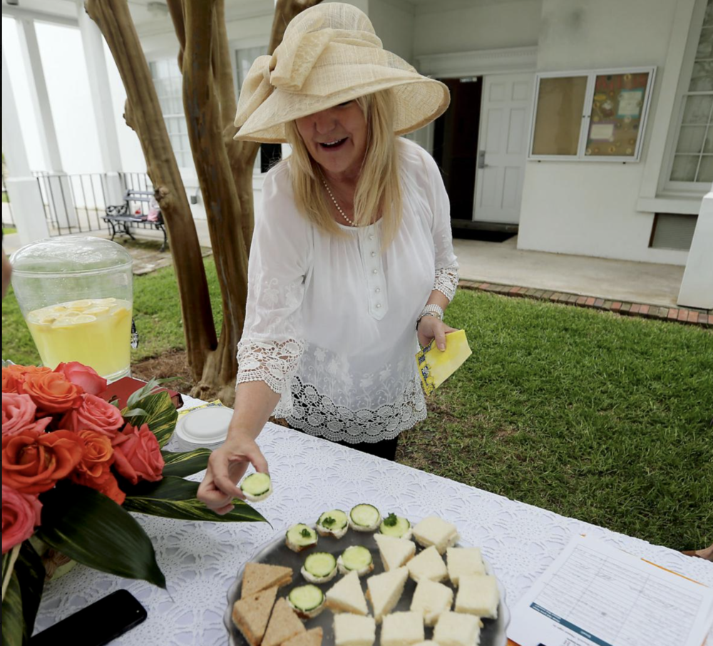 A Spirited Brunch participant enjoying delicious snacks offered during her visit.