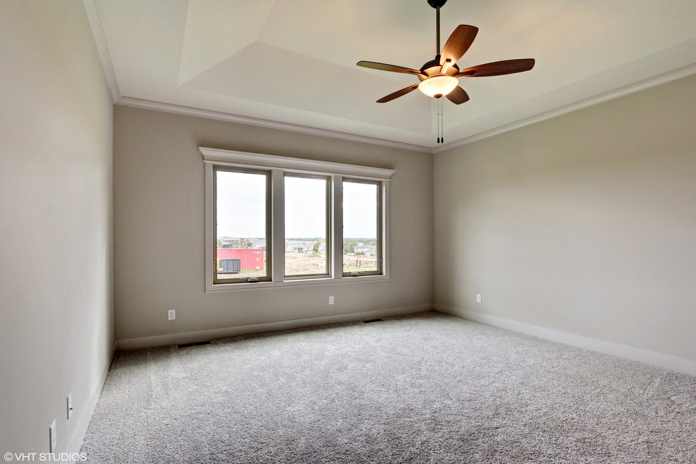 14_3104SWMuirDr_14_MasterBedroom_HiRes.jpg