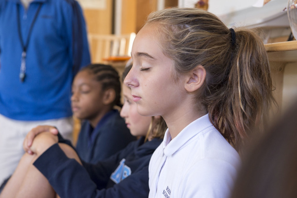 Elementary students engaged in daily mindfulness meditation practice.