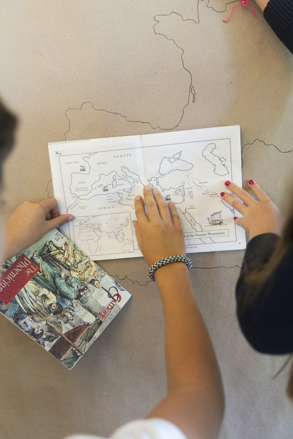 Ross Elementary students work together on a large-scale map of the Phoenician's voyages in their Cultural History