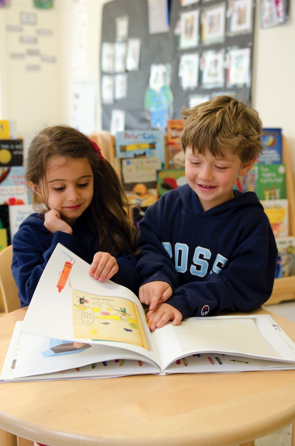 Ross Lower School students enjoying small group reading time.