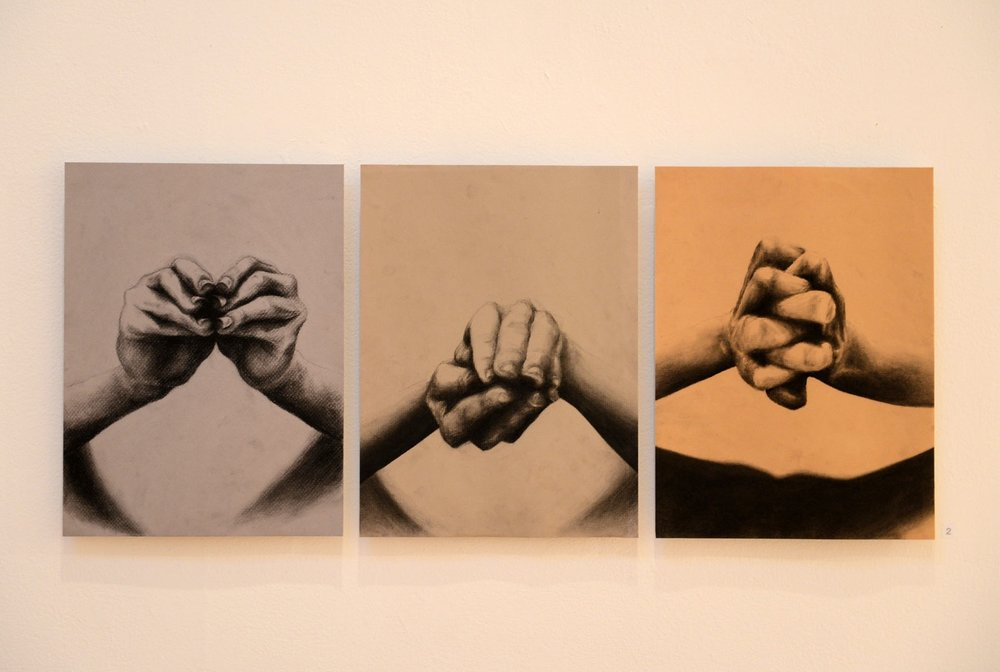 Installation of three large-scale, detailed sketches of clasped hands in different positions