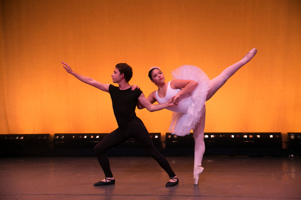Male and female Ross Upper School students on stage in a ballet performance.