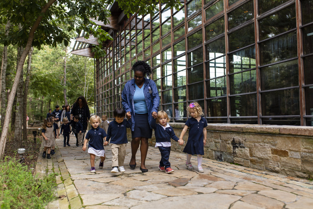 Early Childhood students on the path through campus guided by caring, certified educators.